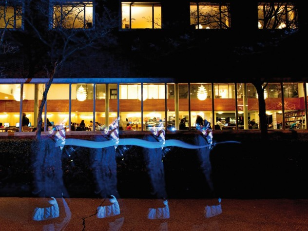 Students study for finals at night in Lamont Library, open 24 hours.