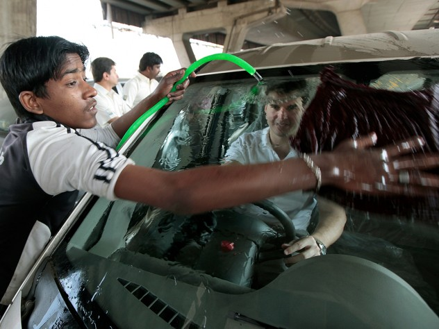 Visiting a Mahindra First Choice Wheels used-car dealership in Mumbai to advise the chain on better connecting with its customers, first-year M.B.A. students left no detail unnoticed. Here, Mike Diverio gets behind the wheel of a Tata Nano being washed by a worker.