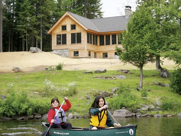 Paddling on Long Pond with the Appalachian Mountain Club's Gorman Chairback Lodge in the background