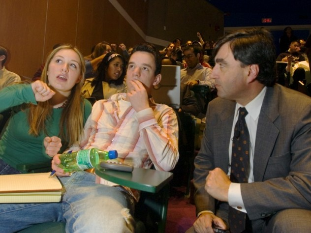 In 2006, Mazur introduced wireless polling in his introductory physics course, during which these photographs were taken. Here Chelsey Forbess '07 and Jonathan Paul '07 discuss results with Mazur...