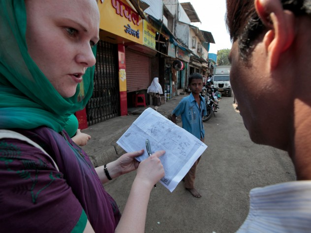 A group of public-health students practiced field methods by studying sanitation in Mumbai's Cheeta Camp slum. Here, Rosemary Wyber maps the locations of toilet buildings with guidance from local residents.