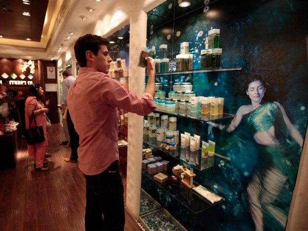 Considering how to position a new product line involves becoming acquainted with other products on the market. M.B.A. student Frederic Dijols reads product descriptions at The Nature's Co., a chain store that emphasizes use of natural ingredients and the influence of Ayurveda (Indian traditional medicine).