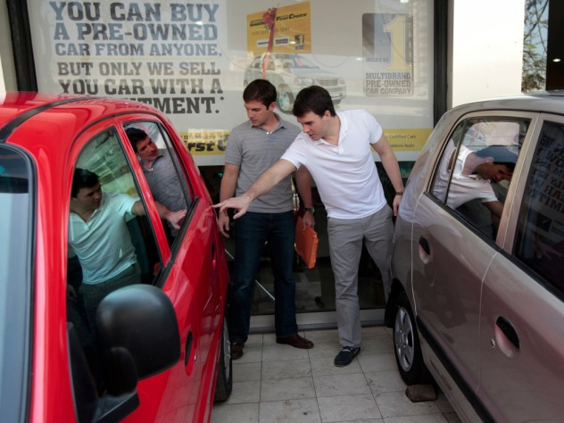 Nick Phoutrides and Diverio tour the car lot.