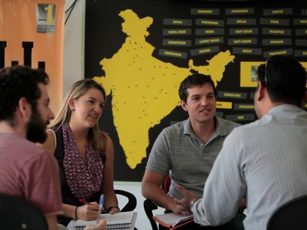 Josh Petersel, Nyssa Liebermann, and Phoutrides interview a customer.