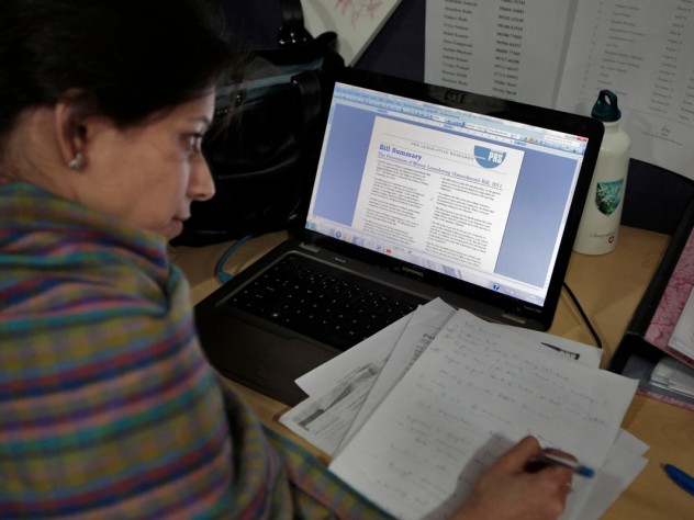 Khanna's students also learn about PRS Legislative Research, a Delhi-based nonprofit organization that provides research briefs to members of Parliament on bills they are considering. Here, a researcher works on a brief in the PRS office.