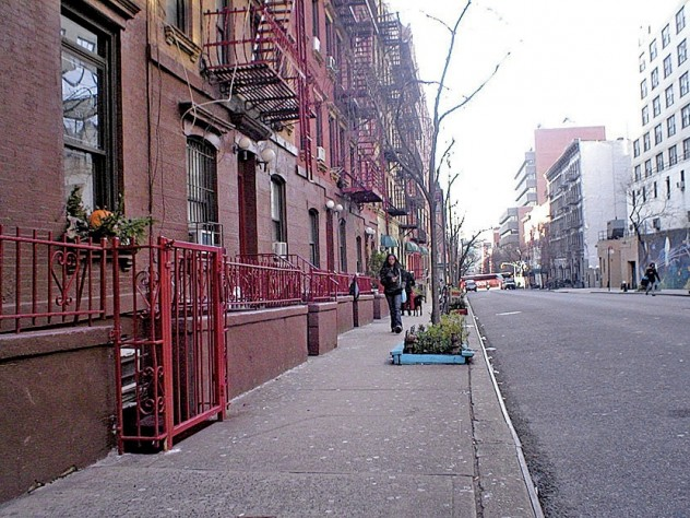 "A recent photo of the Hell's Kitchen block on West 56th Street between Ninth and Tenth Avenues, Manhattan, where the cover of the 1957 <i>West Side Story</i> cast album (superimposed in the next image) was shot. Egan spotted the address ""418 W 56 St"" on the garbage can to the left of the heroine, Maria."