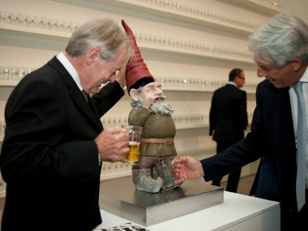 A viewer pumps the headgear of a <i>Pissing Gnome,</i> causing the gnome to urinate beer.