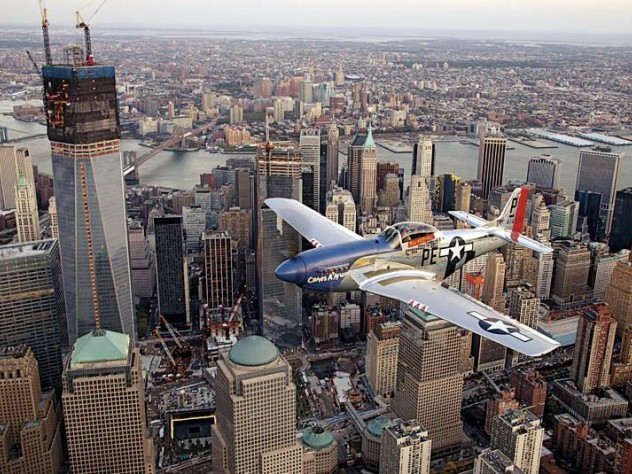 A World War II-era North American P-51 Mustang over New York City