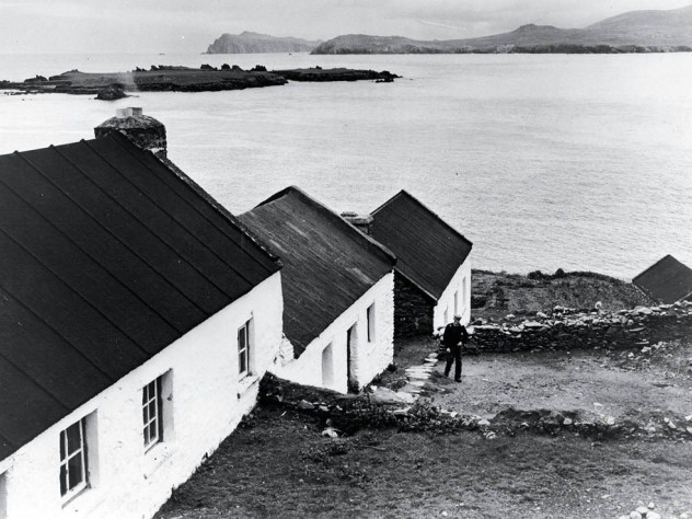 Blasket Island home: The National School (left, upper image) and the Carneys' home (middle structure), with father Seán Tom Ó Ceárna outside.