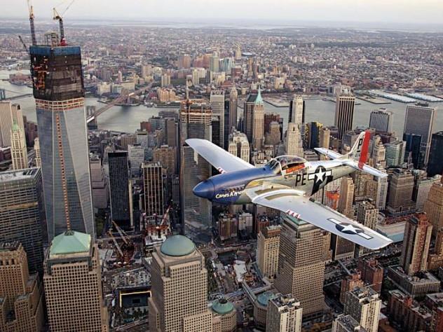 A World War II-era North American P-51 Mustang over New York City