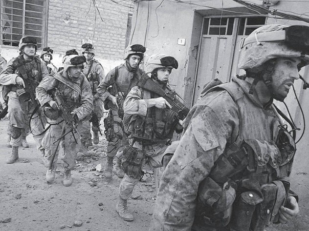 Moulton (at right) leads a mission in Najaf.