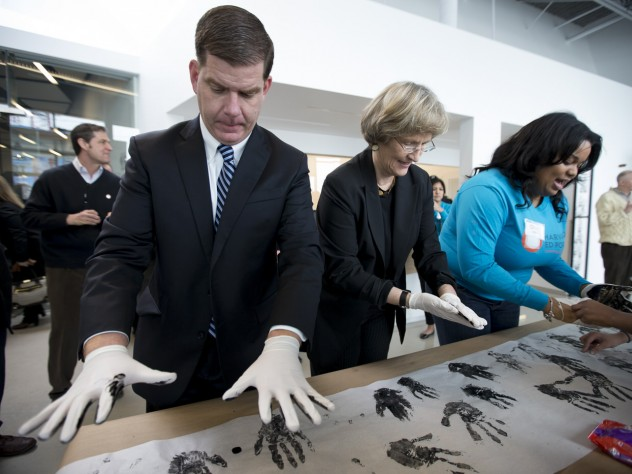 Harvard University president Drew Faust and Boston mayor Martin J. Walsh participate in a community art project at the opening of the Ed Portal's new building in Allston.
