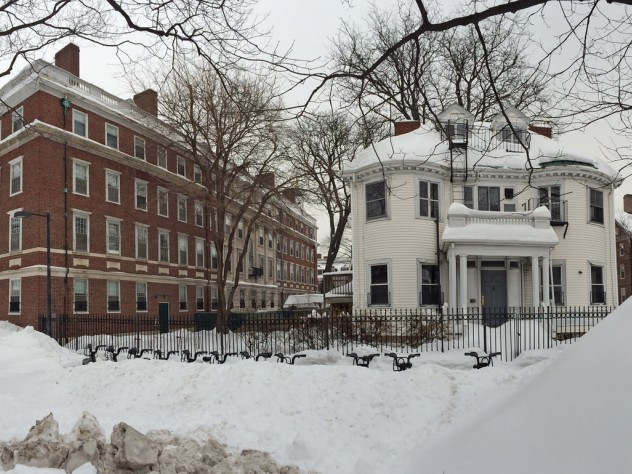 The white wood frame house will become the Winthrop House Master's residence. An addition will connect it to Gore Hall, at left.