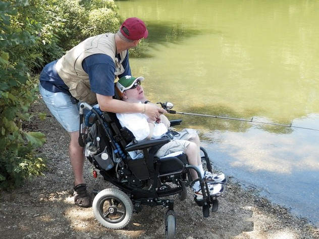 Tim Stevens, a longtime patient, fishes with his stepfather.