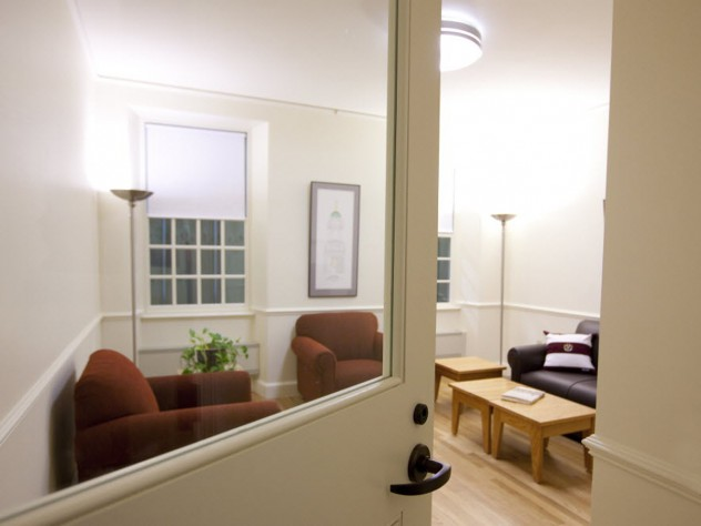 """A life-size model of a renovated Old Quincy suite includes a hallway, a """"cluster"""" common room, a bathroom, a single bedroom, and a double bedroom set up in the parking garage at One Western Avenue, where contractors, architects and administrators can tour the mock-up. Click the """"right arrow"""" below or use the arrow buttons on your keyboard to see more images."""