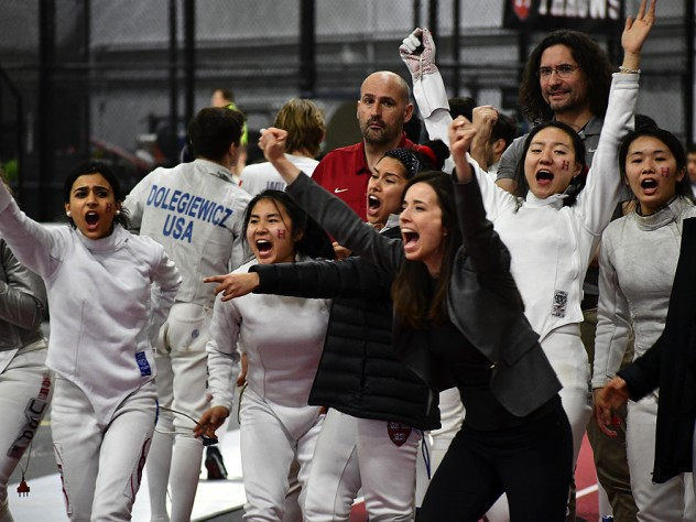Coaches and members of Harvard's women's fencing team celebrate