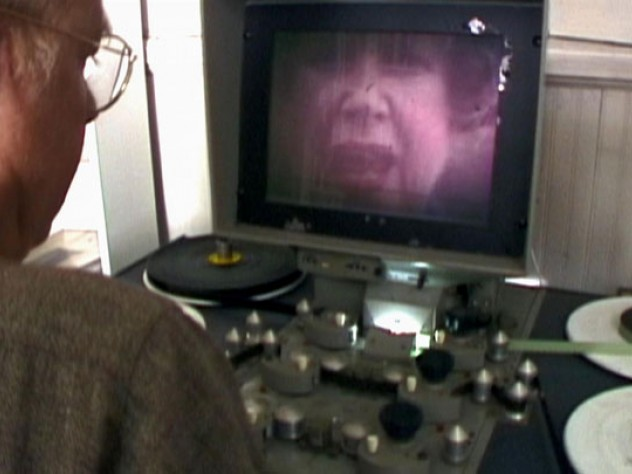 A still from Olch's film shows Richard Rogers at his editing console, watching footage of his mother