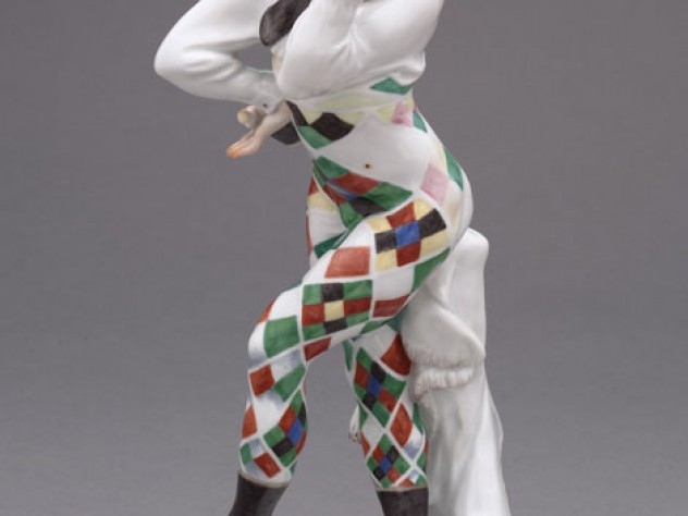 A painted porcelain figurine of Nijinsky as Harlequin in <em>Carnaval</em>