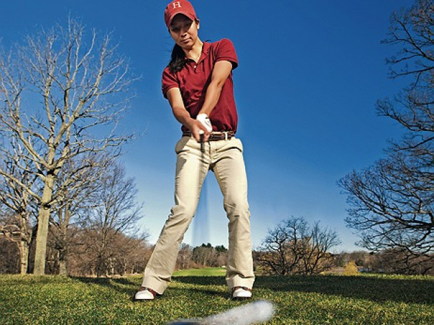 At the Fresh Pond Golf Course in Cambridge, Emily Balmert '09 of the women's golf team—the first Harvard woman to win the Ivy championship—swings into spring.