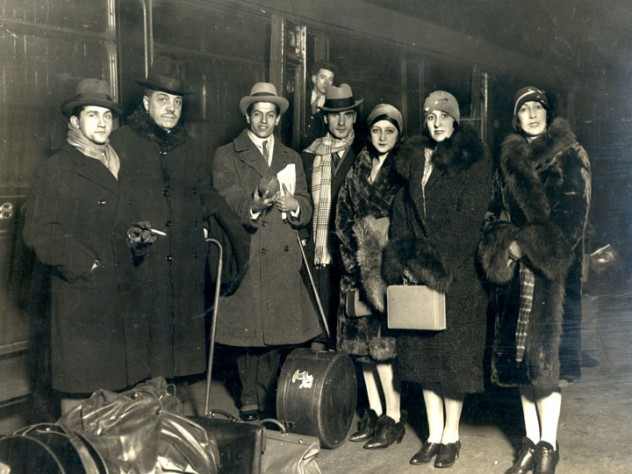 Diaghilev with members of the company, on tour at the train station in Liverpool, England, 1928