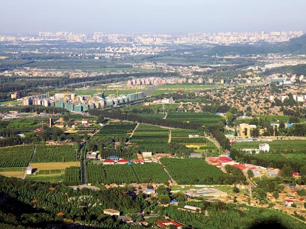 Development sprawls ever-outward from Beijing (in background, right) toward rural Sujiatuo.