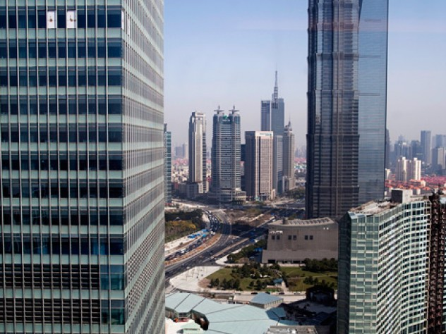 Harvard Center Shanghai is in the new office tower to the left (top); the 88-story Jin Mao Tower and 101-story World Financial Center rise to the right.