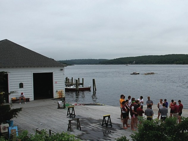 Rowers convene with coach Harry Parker. The boathouse, with its eponymous red cupola, is at left.