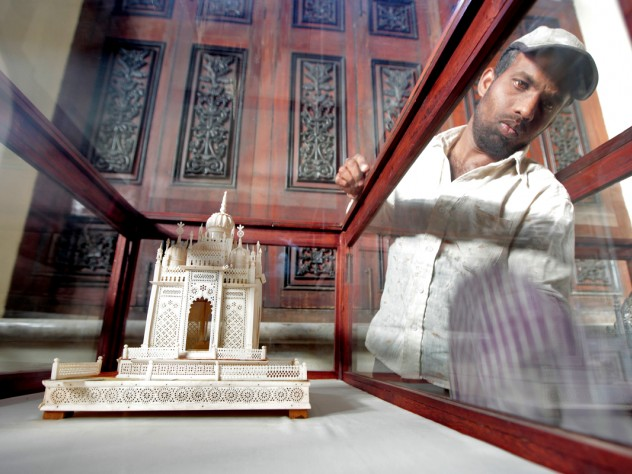 It was important to Princess Esra that the restored palace tell the story of the Asaf Jah dynasty. Here, a worker cleans a historical display.