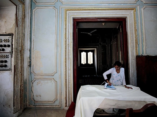 In a workshop area of the palace complex that is closed to the public, seamstresses sew and iron dozens of sets of curtains for the palaces.