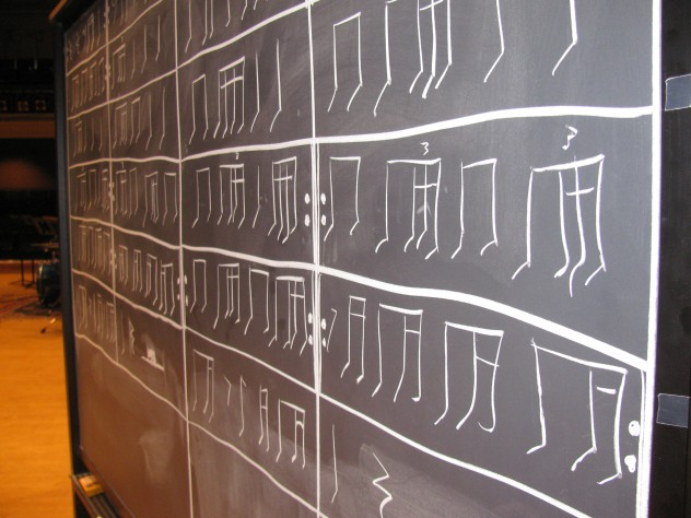 """""""School of THUD"""" also involved rhythms tapped with chalk on a chalkboard. The musicians draw up the score as they play, and play the rhythms forward and backward."""