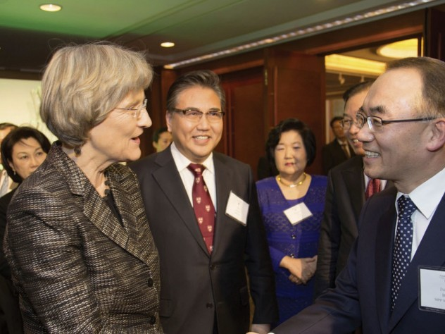 Harvard President Drew Faust shakes hands with Jaewan Bahk, M.P.P. '88, Ph.D. '92, as Jin Park, M.P.A. '85 (next to Faust), looks on during the Harvard Alumni Association dinner in Seoul.