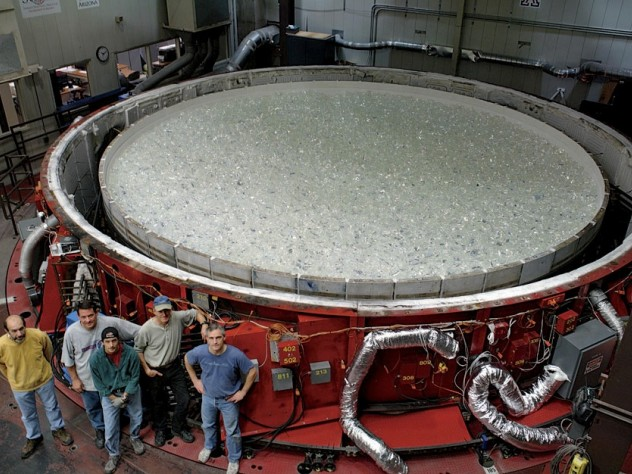 At the Steward Observatory Mirror Lab, in Tucson: with the raw glass in place, the rotary kiln can be covered and prepared for heating.