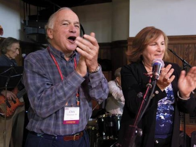 Chris Mortenson and his wife, Winnie, applaud an open-mic music session