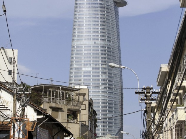 Complete with heliport, the Bitexco Tower rises over traditional Ho Chi Minh City.