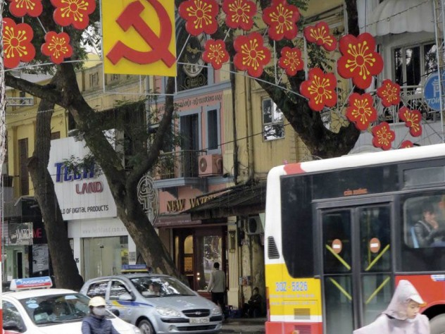 Lest anyone forget, Vietnam remains a Communist Party state, as a street decoration in central Hanoi suggests.