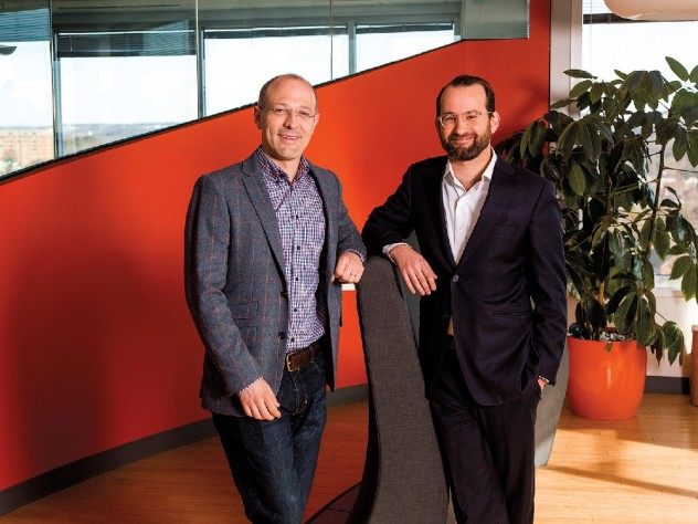 Yates (left) and Laskey have merged their talents—computer science and political communications—in Opower.