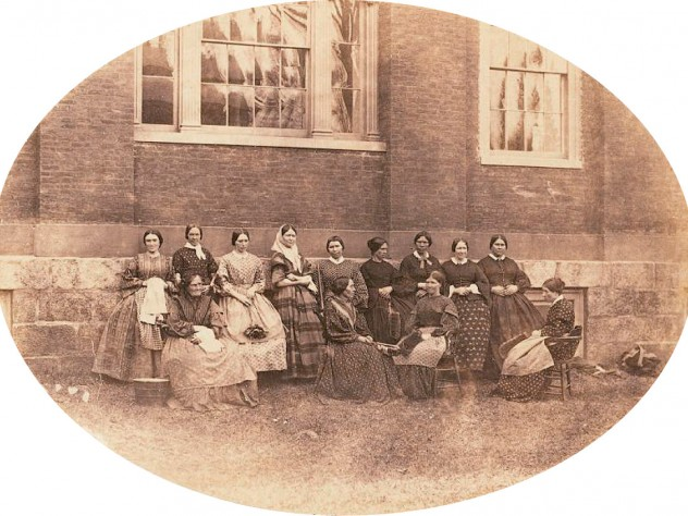 """A group portrait of the College housekeepers, then known as """"goodies"""""""