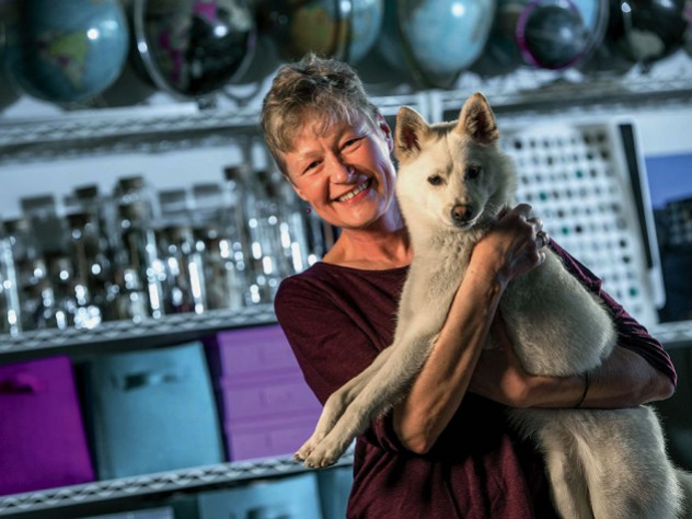 Linnea Olson, shown with her dog, Kumo, has survived 13 years with lung cancer.