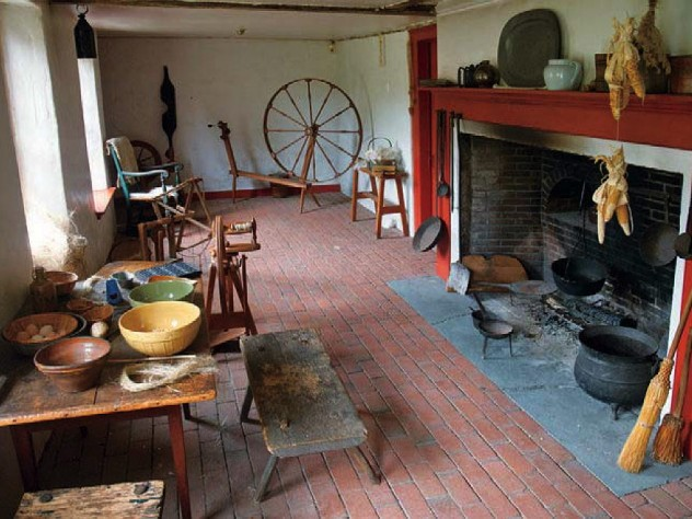 Open hearth, spinning wheel, and other elements in the colonial-era Sylvanus Brown House in Pawtucket, Rhode Island