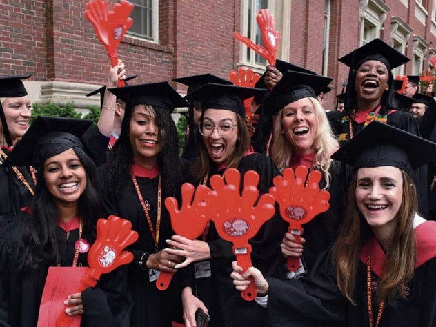 Harvard students in caps and gowns enjoying Commencement