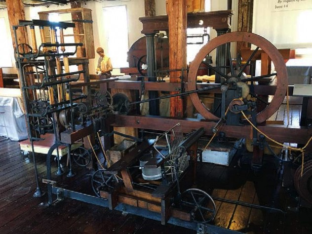 View of early mill machinery constructed of wood and metal