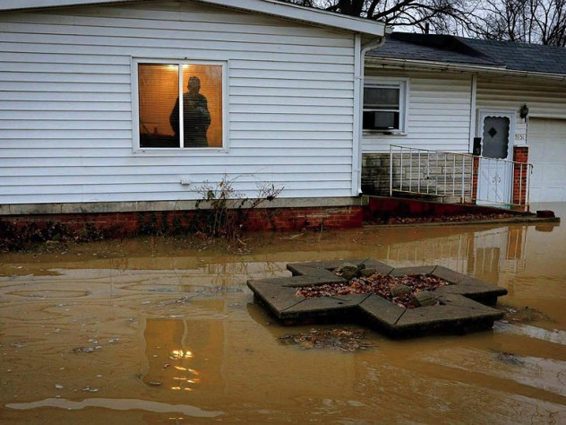 Centreville resident Earlie Fuse looks out his home window at the flooding that his filled his yard.