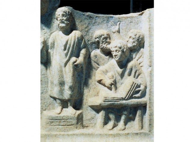 Photograph of a carved relief showing orator dictating to a scribe, from the fourth-century Roman Temple of Hercules at Ostia Antica