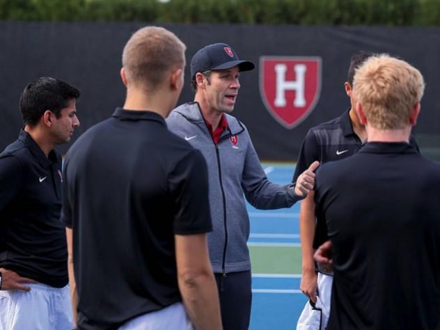 Andrew Rueb speaks to members of his team.