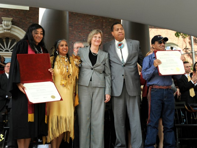 Tiffany Smalley '11; Cheryl Andrews-Mahats, Aquinnah Tribal Council Chair; Drew Faust; Cedric Cromwell, Mashpee Tribal Council Chair; and Bernard Coombs of the Mashpee Tribe receiving a posthumous diploma for Joel Iacoomes, who would have graduated in 1665.