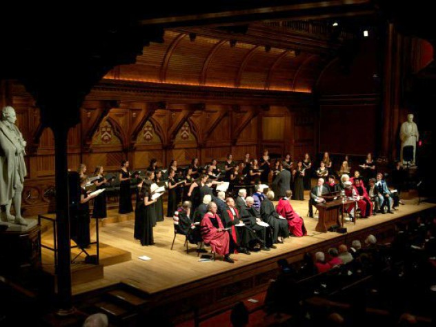 The Radcliffe Choral Society sings behind the Phi Beta Kappa officials, honored guests, and speakers during the literary exercises in Sanders Theatre.