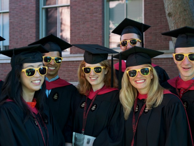 """Ready for anything, Harvard Business School M.B.A.s-to-be fend off the sun in their matching """"HBS Section J 2012"""" shades."""
