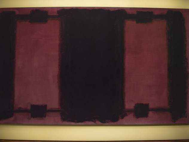 The background of Mark Rothko's <i>Panel Four</i> exhibits different stages of color loss. The digital light projection technology illuminates the panel differentially, restoring the uniform original color.
