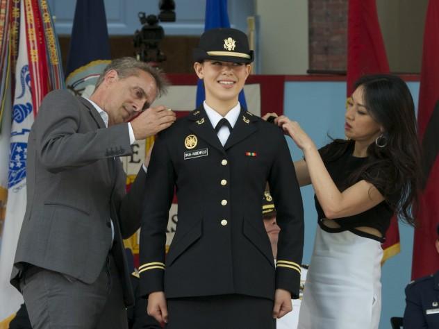 Sophia Chua-Rubenfeld's parents pin on her insignia.