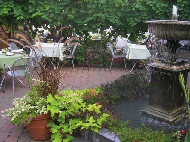 Request a spot on Stellina's Italian-style back terrace.